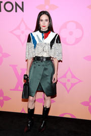 Jennifer Connelly showed off her unique style with this paneled, abstract-print blouse at the Louis Vuitton X: An Immersive Journey event.