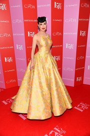 Dita Von Teese looked radiant in a yellow halter ballgown by Zac Posen at the 2019 Love Ball III.