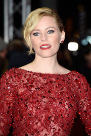 For the 'Love & Mercy' premiere, Elizabeth Banks styled her hair into a French twist with wavy bangs falling down one side of her face.