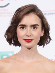 Lily Collins rocked a short wavy bob at a photocall for 'Love, Rosie' during the 9th Rome Film Festival.
