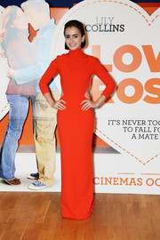 Lily Collins stepped out in a bright red Solace London gown with cut-out panels at the world premiere of 'Love, Rosie.'