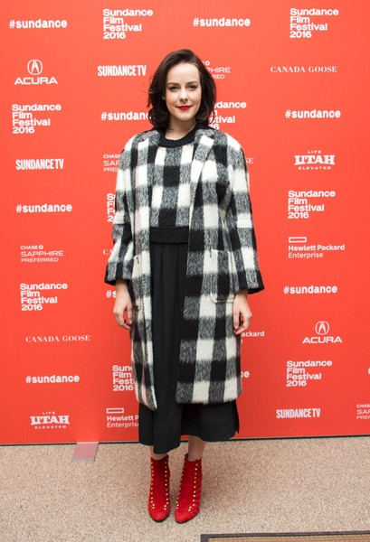 Jena Malone layered a plaid coat over a matching dress by Sea New York for the Sundance Film Festival premiere of 'Lovesong.'