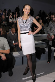Petra donned a playful silk print blouse with a high-waisted pencil skirt for the Luca Luca fashion show in NYC.