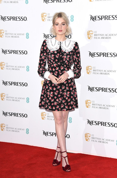 Lucy Boynton Print Dress [clothing,dress,red carpet,carpet,fashion model,footwear,hairstyle,fashion,premiere,cocktail dress,nespresso,red carpet arrivals,lucy boynton,british academy film awards,england,london,kensington palace,nominees party,nominees party]