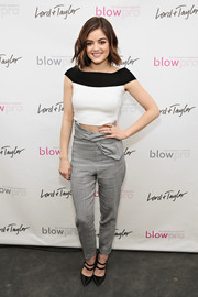 Lucy Hale stayed on trend in a black-and-white crop-top by RVN at the Blowpro launch.