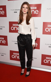 Rose Leslie contrasted her delicate blouse with edgy black leather pants.