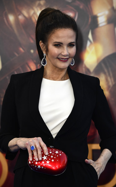 Lynda Carter Printed Clutch [premiere of warner bros. pictures,lip,fashion accessory,engagement ring,blazer,nail,jewellery,suit,formal wear,games,wonder woman,lynda carter,arrivals,california,hollywood,pantages theatre,warner bros. pictures,premiere]