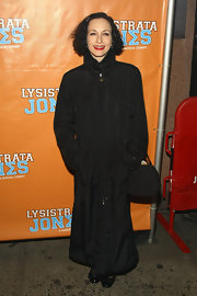 Bebe Neuwirth drowned her pettie frame in an overwhelming black floor length coat.