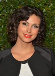 Morena Baccarin chose tight ringlet curls for her evening hairstyle at the 'Vogue' and MAC Cosmetics Dinner party in LA.