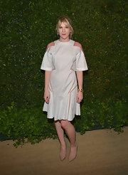 Lily Rabe chose a loose white frock that featured pink lace sleeves, geometric cutouts, and a flared skirt.
