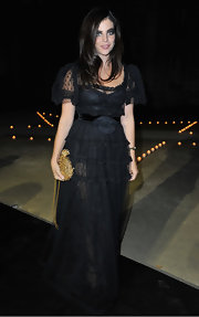 Carine Roitfeld polished off her look with a gold chain-strap bag.