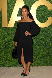 Angela Bassett went the boho-chic route in a black off-the-shoulder dress with blouson sleeves at the MACRO pre-Oscar party.