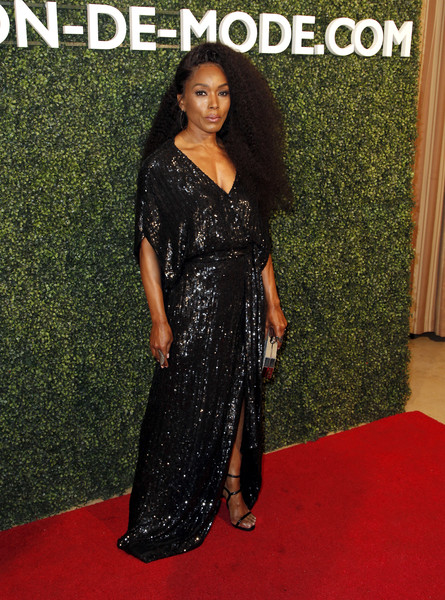 Angela Bassett polished off her look with strappy black heels by Le Silla.