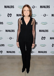 "Gloria Steinem chose classic black pants to match a see-through black blouse at the 'Makers: Women Who Make America"" premiere."