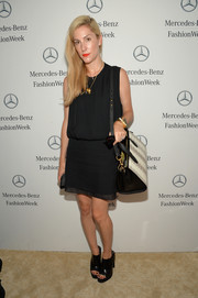 Joanna Hillman went for an edgy finish with a pair of black open-toe booties.