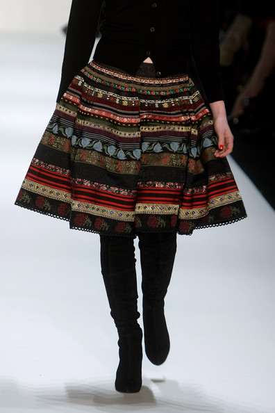 Barbara Meier walked down the runway in a printed knee-length skirt during the Lena Hoschek Fashion Show.