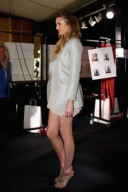 Whitney Port added a bold pair of woven metallic gold booties at the Whitney Eve fashion show in Sydney, Australia.