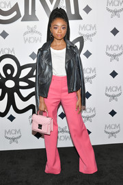 Skai Jackson completed her ensemble with a studded pink leather purse by MCM.