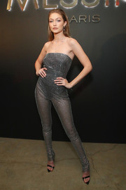 Gigi Hadid looked beguiling in a sheer, crystal-covered jumpsuit by Gasanova at the launch of her Messika collection.