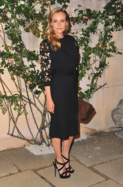 Style darling Diane Kruger looked ultra chic black Miu Miu dress that she finished off with black strappy heels and side swept curls.
