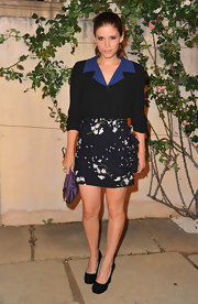 Kate Mara balanced her girly floral print mini with a pair of black suede pumps at the Miu Miu 'Muta' presentation.