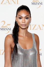 Chanel Iman attended the Mizani 25th anniversary event wearing her hair in a fishtail braid.