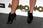Kimberly shoes off her toned gams in these black ankle boots, that pull inspiration from a mens oxford dress shoe.