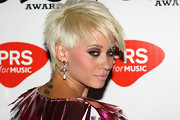 "Kimberly Wyatt of the popular girl group ""Pussycat Dolls"", chopped off her long blonde locks earlier this year for a short spiked cut. Her new hair cut definitely gives her some edge and adds some diversity to the girl group."