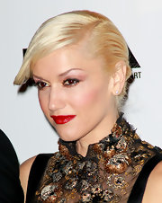 Gwen Stefani showed off her sleek french twist, that was neatly tucked in a low bun. She topped off her look with classic red lipstick.