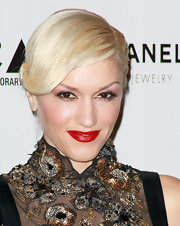 Gwen Stefani showed off her signature red lips while attending The Artist's Museum Happening. Her look was completed with a low french twist.