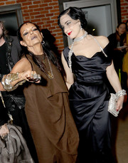 Dita Von Teese attended the opening of 'Rick Owens: Furniture' carrying a super-sparkly crystal clutch.