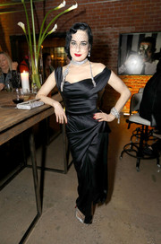 Dita Von Teese was her usual glam self in a structured black off-the-shoulder gown at the opening of 'Rick Owens: Furniture.'