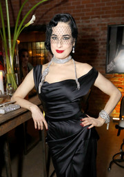 Dita Von Teese got all blinged up with a chunky crystal bracelet and a matching choker for the opening of 'Rick Owens: Furniture.'