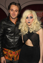 Lady Gaga paired her blue lipstick with marching midnight blue shadow rimmed around her entire lids.