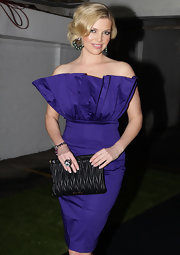 Rebecca paired her strapless purple dress with a quilted leather clutch.