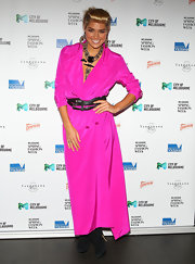 Ashley Hart stepped out at the opening soiree of Spring Fashion Week wearing a hot pink trench dress.