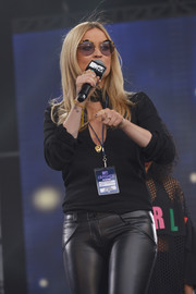 Laura Whitmore spoke onstage at the MTV Crashes Coventry event wearing a cute pair of round shades.
