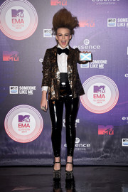 Tallia Storm styled her menswear-inspired outfit with a sparkly Swarovski clutch.