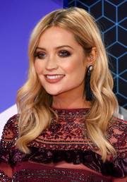 Laura Whitmore played up her eyes with smoky makeup.