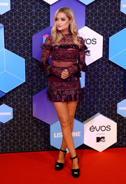 Laura Whitmore teamed her flirty dress with chunky black sandals.