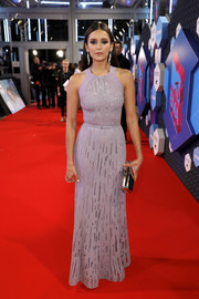 Nina Dobrev arrived for the MTV EMAs looking regal in a beaded lavender gown by Elie Saab.