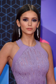 Nina Dobrev finished off her glam look with a pair of dangling diamond earrings by Michael John.