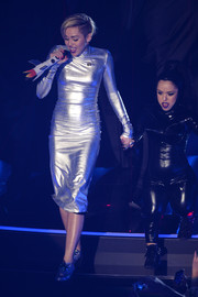 Miley Cyrus complemented her dress with a pair of iridescent brogues.