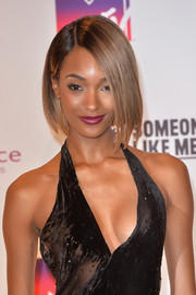 Jourdan Dunn capped off her look with a vampy berry lip.