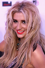 Kesha toned her look down with a simple application of red lipstick and metallic eyeshadow.