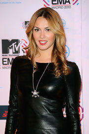 Priscilla finished off her leather clad dress with a skull pendant neckalce.