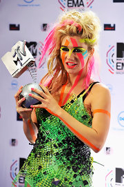Kesha showed off her eccentric style while hitting the MTV Europe Awards. She topped off her lime green mesh dress with bold swipes of bright eyeshadow.
