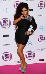 Oh Snooki, how we love you and your brazen Jersey style! The petite Jersey Shore star sparkled at the MTV Europe Awards in a pair of jewel encrusted platform pumps and a black mono-sleeved mini dress. Big hair with red accents and extra long faux nails topped off her red carpet look.