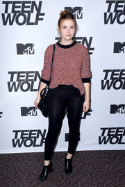 Holland Roden opted for a casual red crewneck sweater when she attended the MTV 'Teen Wolf' 100th episode screening.