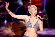 Miley Cyrus flashed plenty of skin in a sequined bikini top by Ashish while performing on 'MTV Unplugged.'